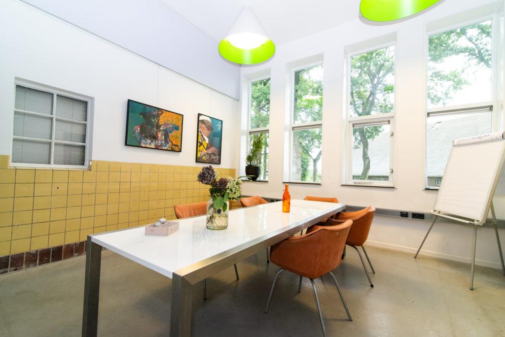 Impressie groene subzaal ruimte boeken